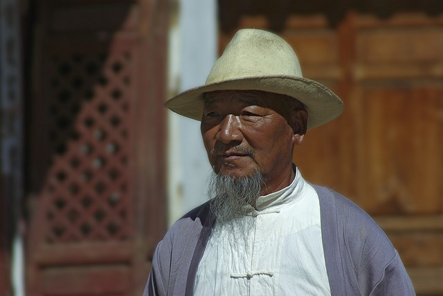 cc photo via flickr user Ray Devlin: a villager at Baisha